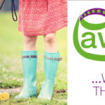 35330156 - young woman in dress and turquoise wellies walk her beagle dog in a park